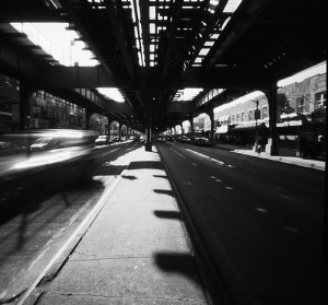 """""""Underneath the elevated subway tracks along Brighton Beach Avenue"""" by gmpicket on Flickr"""