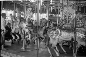 People Riding Carousel, 1938 by Reginald March. mcny.org